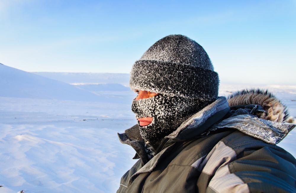 Man in ski mask on snowy day