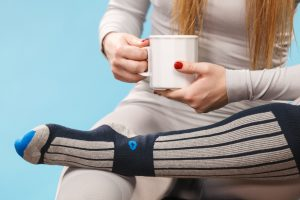 Woman having tea in thermal base layer